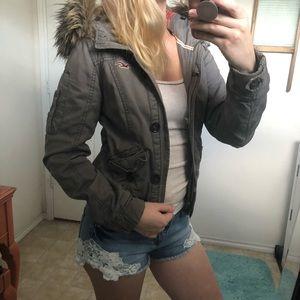 Grey jacket with fur hood